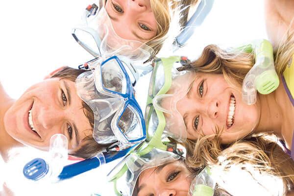 Ces enfants ont l'air ravis de leur journée snorkeling avec Mio Palmo plongée